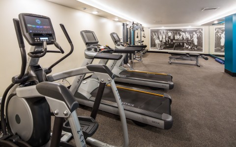 fitness center with plethora of gym equipment