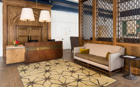 Indigo Baltimore check in has a very retro yet modern feel with reclaimed wood and metals.
