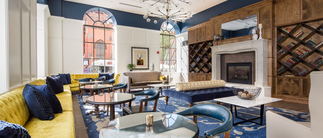 hotel interior is modern yet traditional. Royal blue and yellow accents filled the room of marble tables, leather and velvet riveted and tufter chairs, large fireplace