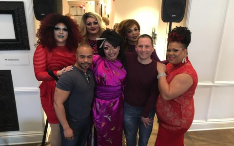 drag queens pose with guest