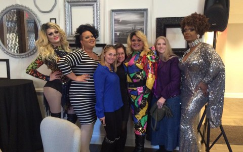 Sunday Drag Brunch. group of drag queens pose with guest