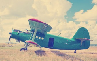 vintage prop plane in field