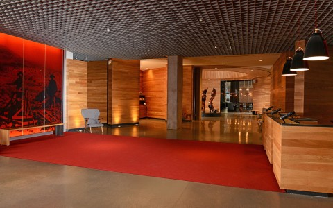 lobby with red carpet and wood paneled walls