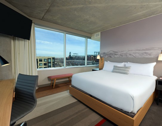 room with king bed and city view