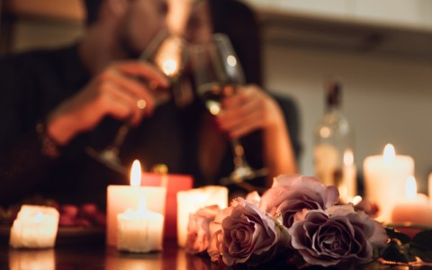 couple has romantic candlelit dinner