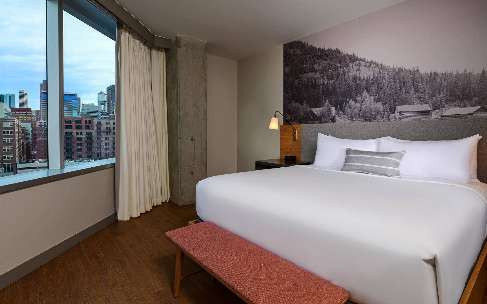 bedroom suite with large picture of mountains in the background