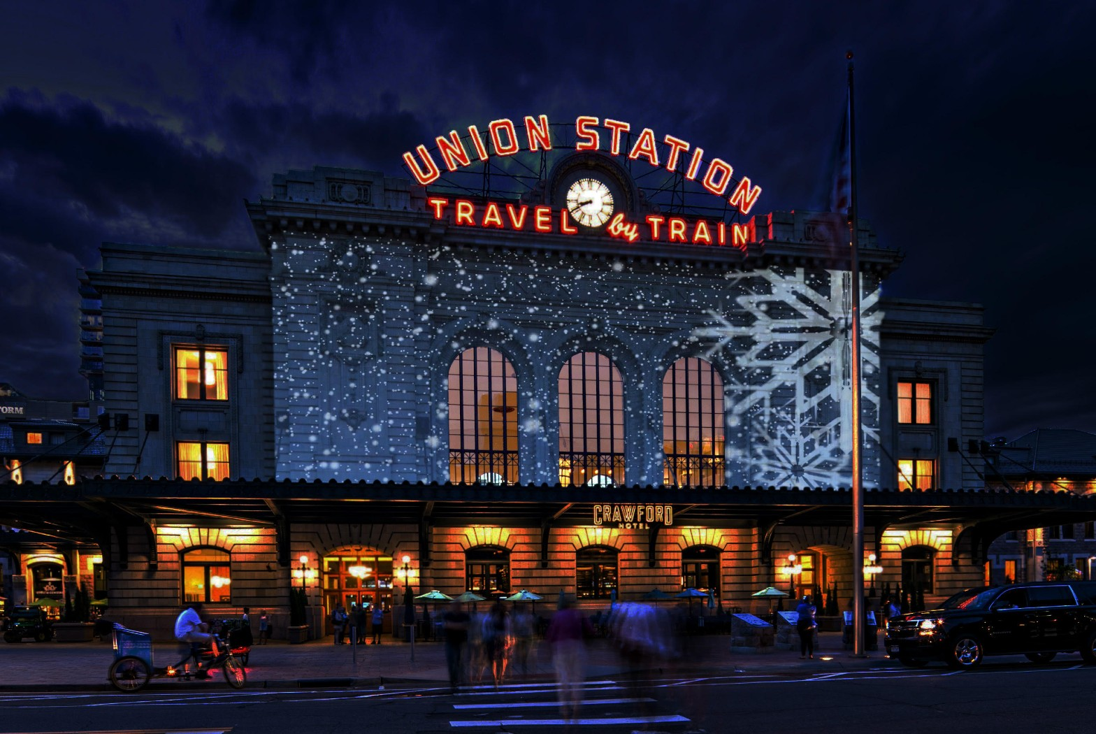 union station at night with snowflakes projected on front of building