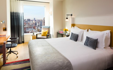 a guest room with city views