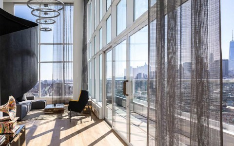 floor to ceiling windows in a penthouse suite