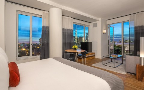 a hotel room with views of the city