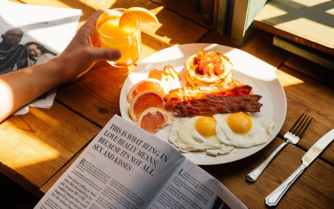 a breakfast plate and newspaper