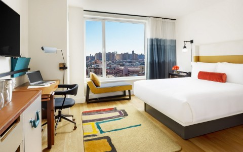 a hotel room with a city view