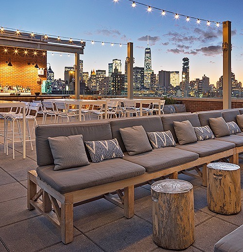 the rooftop deck with string lights