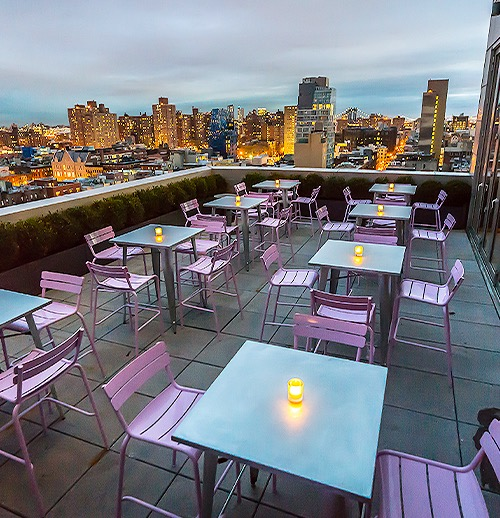 the rooftop with tables and purple chairs