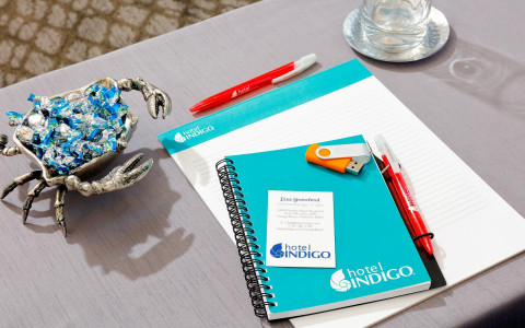 blue notepad with hotel logo