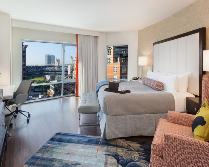 guest room with a king bed and view of the ballpark