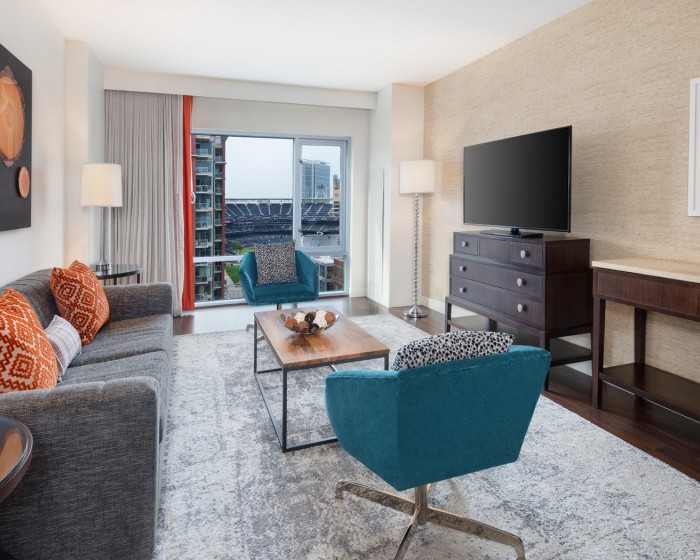 guest suite with living room and view of the ballpark