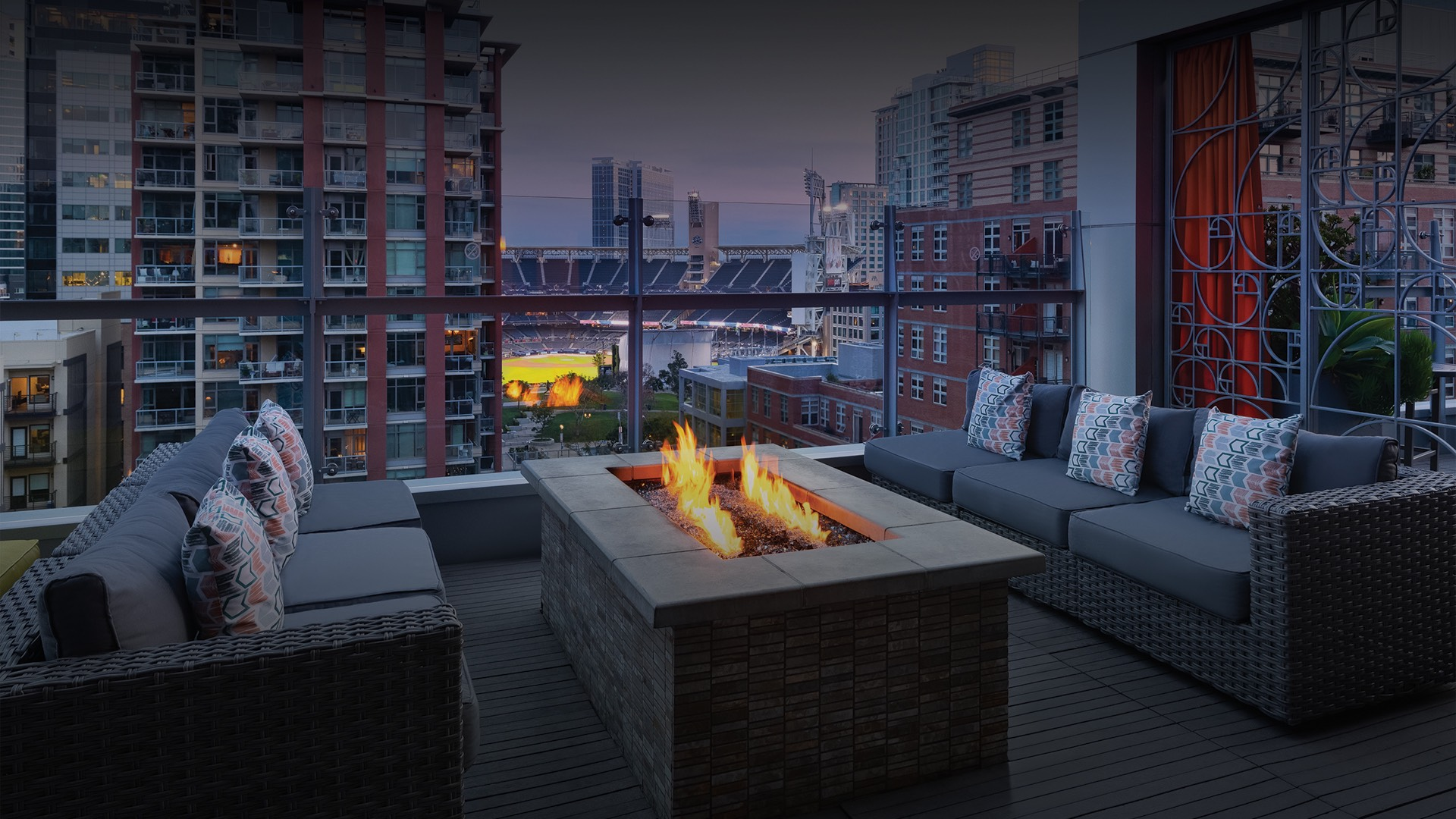 rooftop lounge area with fireplace