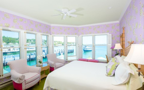 hotel room with pink walls and a view of the docks