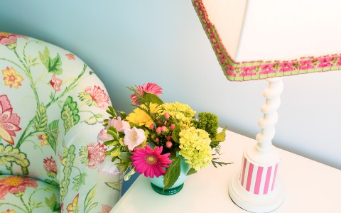 overhead view of nightstand with a lamp and flowers