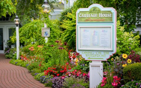carriage house signage in front of entrance