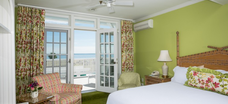 lime green room with balcony and ocean view