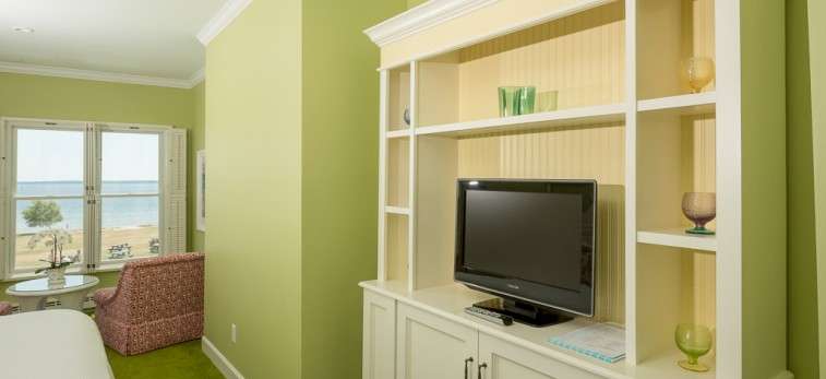 cream colored media cabinet in lime green room