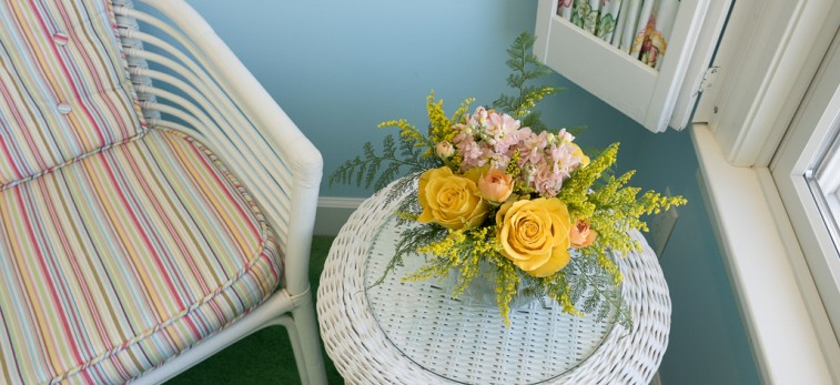 yellow and pink flowers on white wicker table