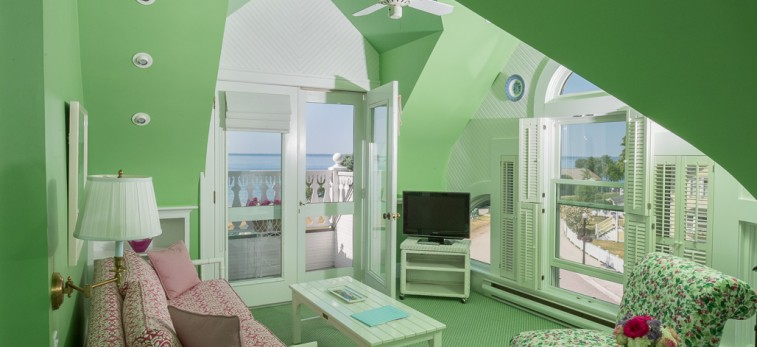 Lime green loft room with flower couch and chairs