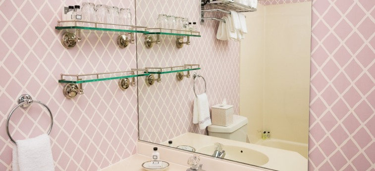 bathroom with light pink walls & sink