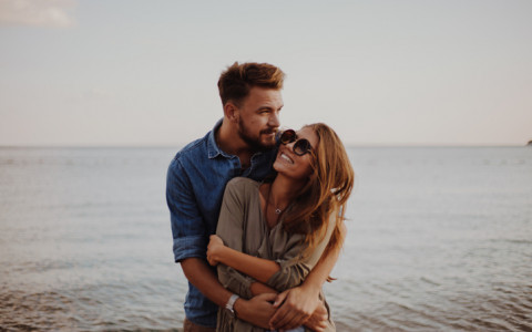 couple embracing by ocean