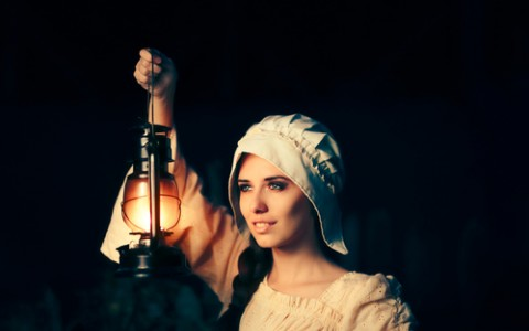medieval woman with vintage lantern