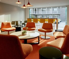 lounge areas of the business center with orange chairs
