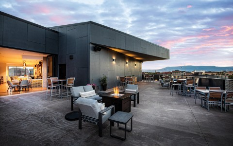 rooftop lounge and dining area with firepit