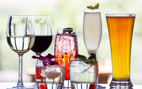 wine glasses, tall beer glass, and cocktails