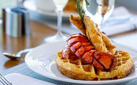 lobster tail on top of waffle