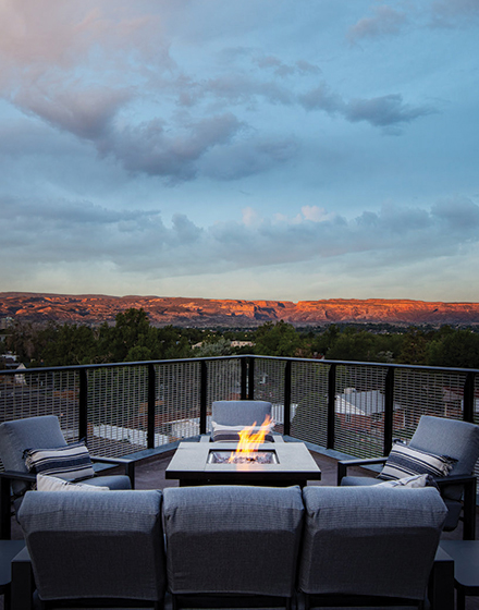 firepit on rooftop with sofa seating