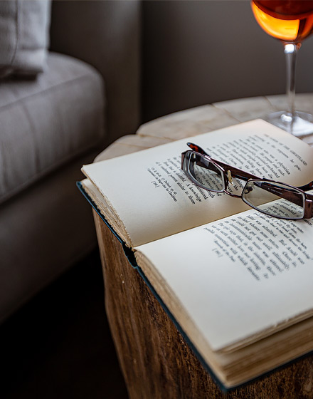 reading glasses sitting on top of open book