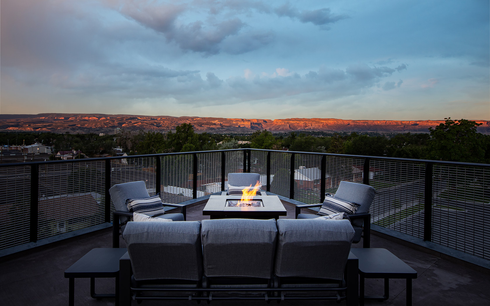 firepit on rooftop with outdoor sofas