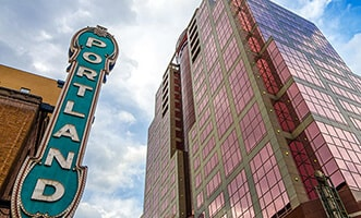 vertical blue Portland sign from below