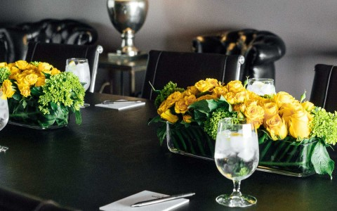 Yellow flower centerpieces on table