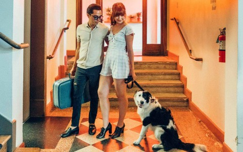 Couple with dog next to elevator