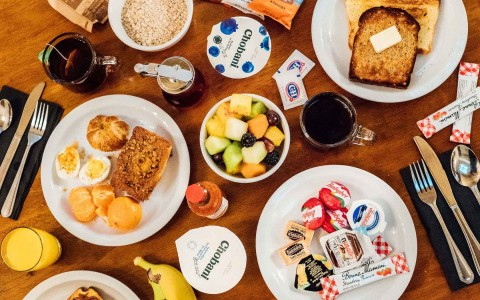 Overhead shot of breakfast foods on table
