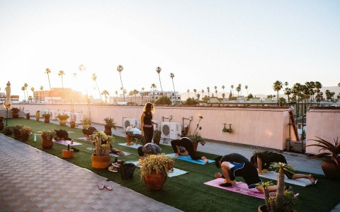 People doing yoga on hotel rooftop