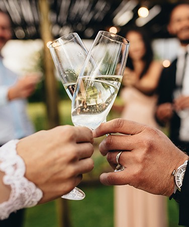 two wedding people toasting with champagne