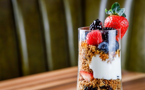 cup of granola, yogurt, and fruit