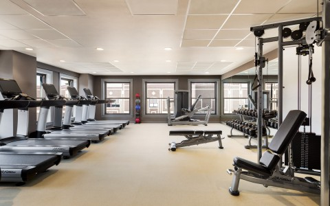 fitness center filled with treadmills and other equipment