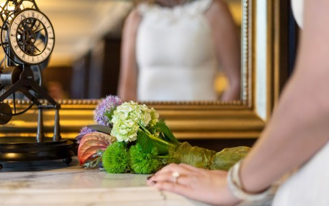 closeup of a brides flower bouquet in front of a mirror