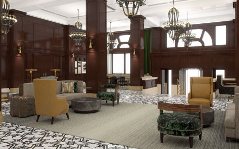 lobby waiting area with mustard yellow chairs, tan couches, green patterned chairs, and black and white patterned floors