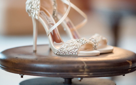 bridal wedding shoes on a wooden stool